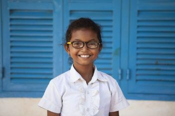 Schoolgirl enjoying good vision with her glasses