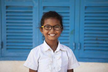 Schoolgirl enjoying good vision with her glasses