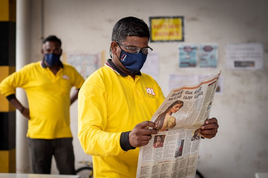 Migrant Worker Trying On Reading Glasses